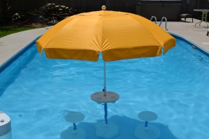 swimming pool tabe with umbrella and chairs Aqua Party Bar